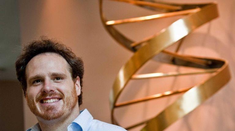 Dr. Michael Schatz stands next to a double