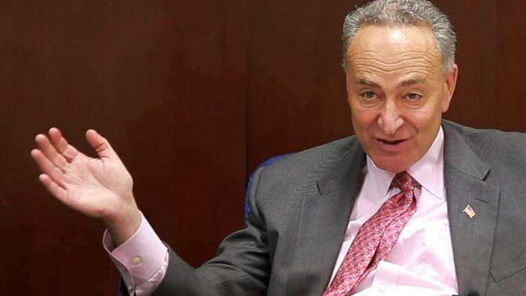 Sen. Charles Schumer talks to editors and reporters