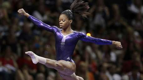 Gabby Douglas competes in the floor exercise event