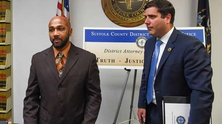 Keith Bush with Suffolk County District Attorney Timothy