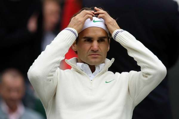 Roger Federer of Switzerland takes a break during