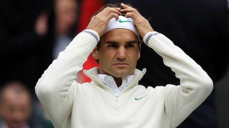 Roger Federer of Switzerland takes a break during