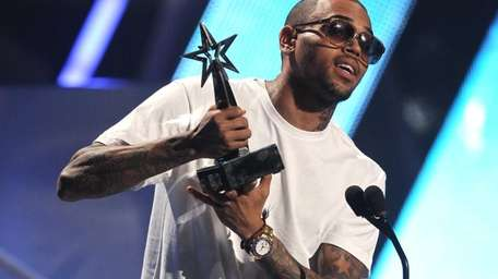 Chris Brown accepts the award for best male