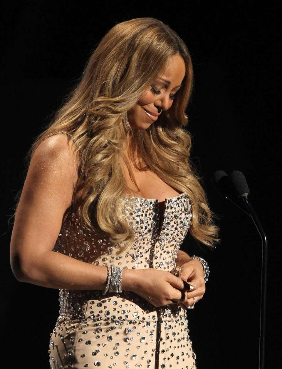 Mariah Carey pauses as she makes a speech