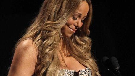 Mariah Carey pauses as she makes a speech