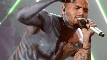 Singer Chris Brown performs onstage during the 2012