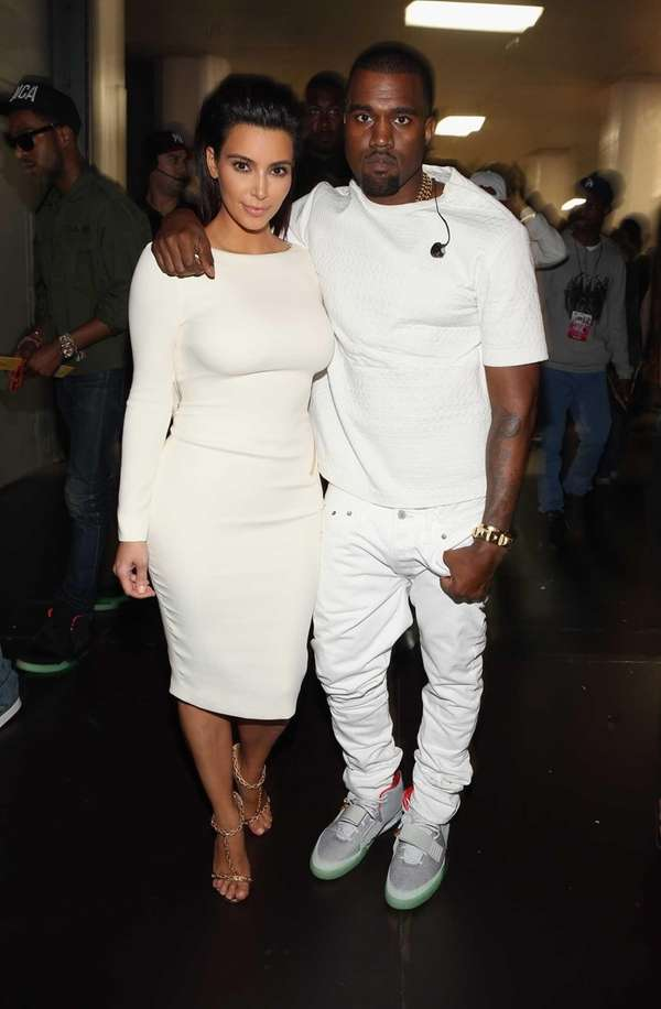 Kim Kardashian and rapper Kanye West attend the
