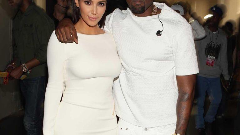 Kim Kardashian and rapper Kanye West attend the