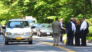 Investigators on Oyster Bay Road in Matinecock, where