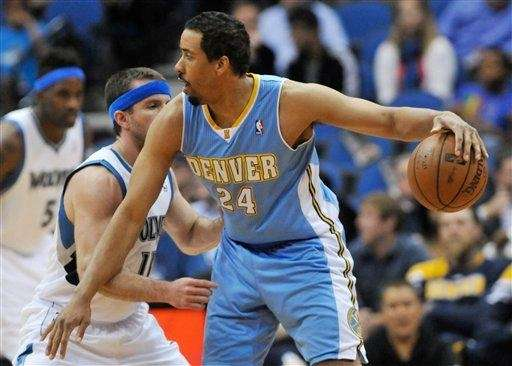 Denver Nuggets' Andre Miller, right, keeps the ball