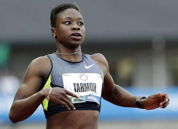 Jeneba Tarmoh finishes first in her heat in