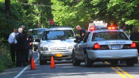 Nassau police investigate the scene where two bodies