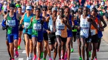 Men's elite runners make their way over the