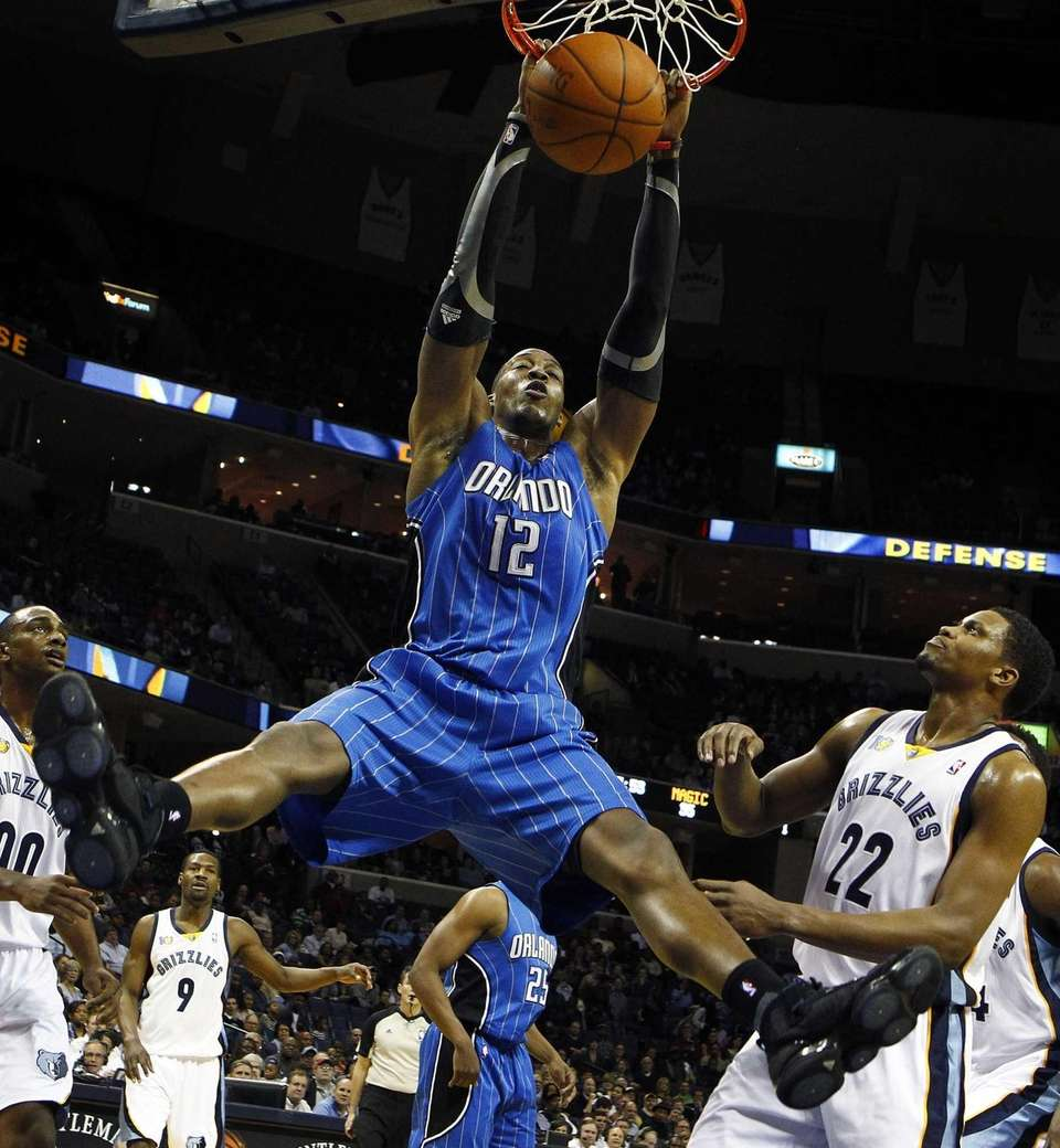 Dwight Howard, dunks over Memphis Grizzlies teammates Darrell