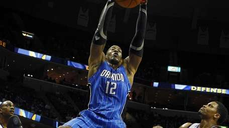 Dwight Howard, dunks over Memphis Grizzlies teammates Darrell