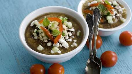 Gazpacho with grilled vegetables and topped with feta