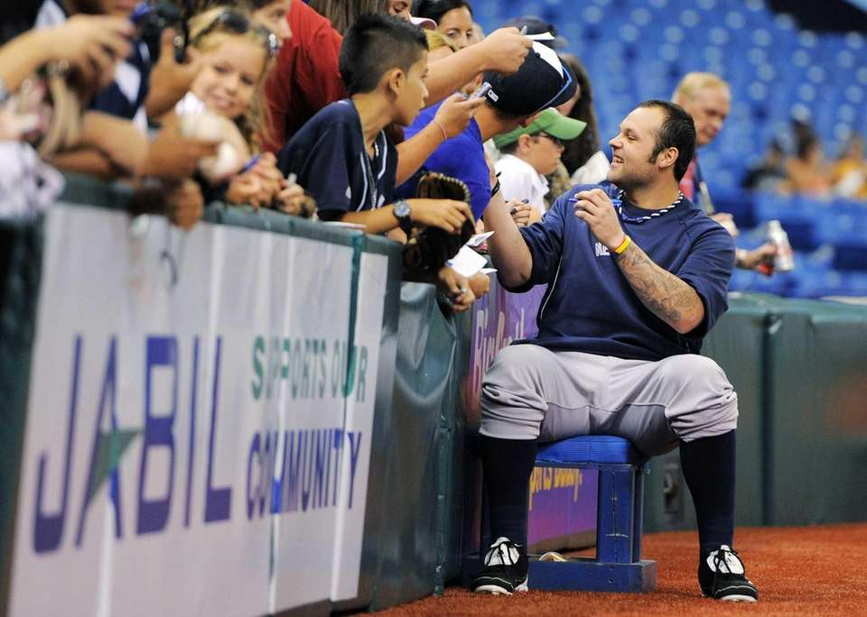 New York Yankees pitcher Joba Chamberlain, right, signs