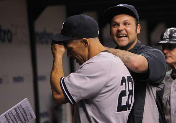 New York Yankees pitcher Joba Chamberlain, right, laughs