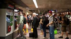 LIRR riders wait in lines to purchase their