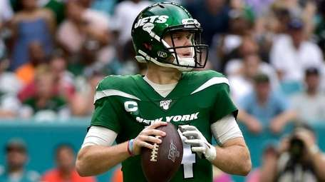 Sam Darnold of the Jets looks downfield during