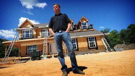 Mark Baisch, of Landmark Properties, stands on the