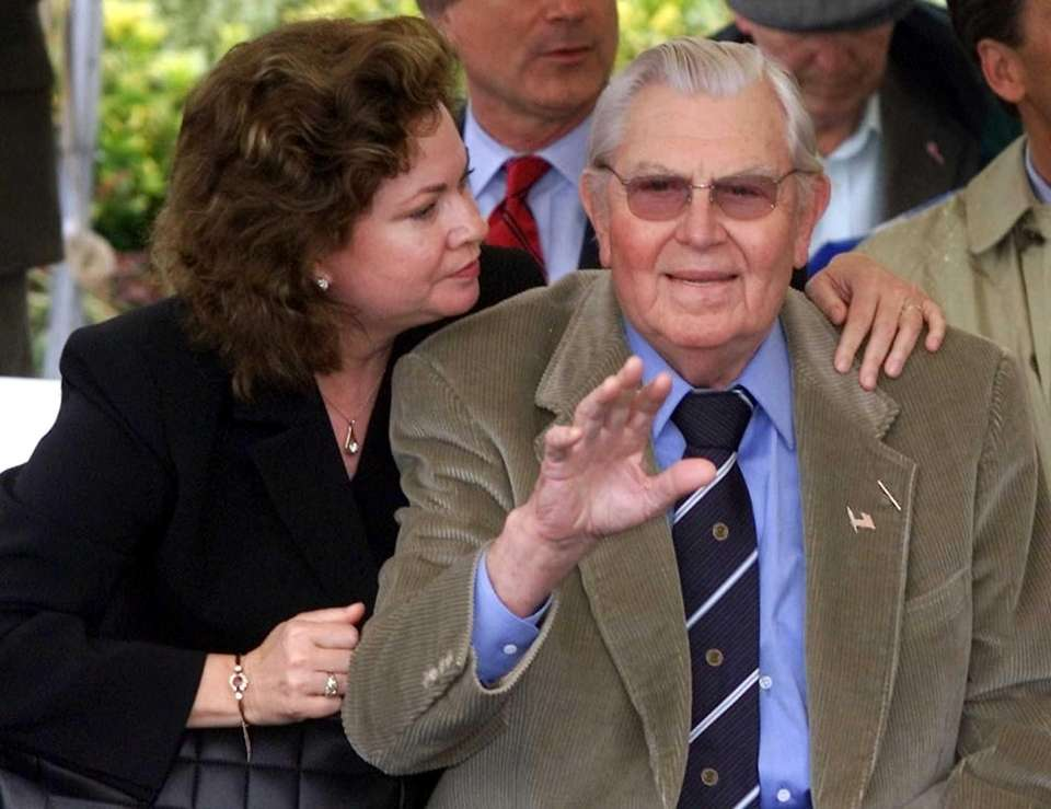 Actor Andy Griffith, right, waves to the crowd