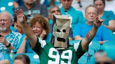 A New York Jets fan wears a paper