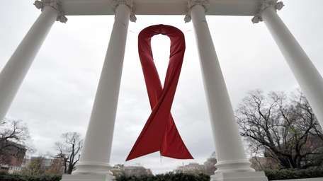 In this file photo, an AIDS symbol is