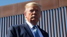 President Donald Trump visits the U.S.-Mexico border fence