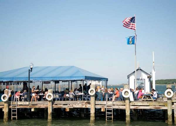 Eat out on the pier at Claudio's Clam