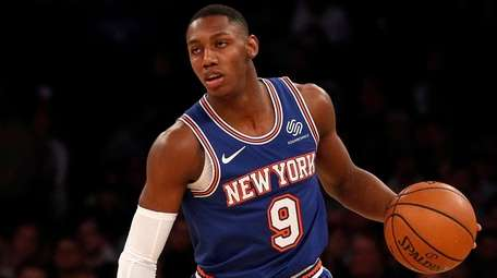 RJ Barrett of the Knicks controls the ball