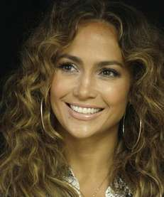 Jennifer Lopez poses for photos after a ceremony