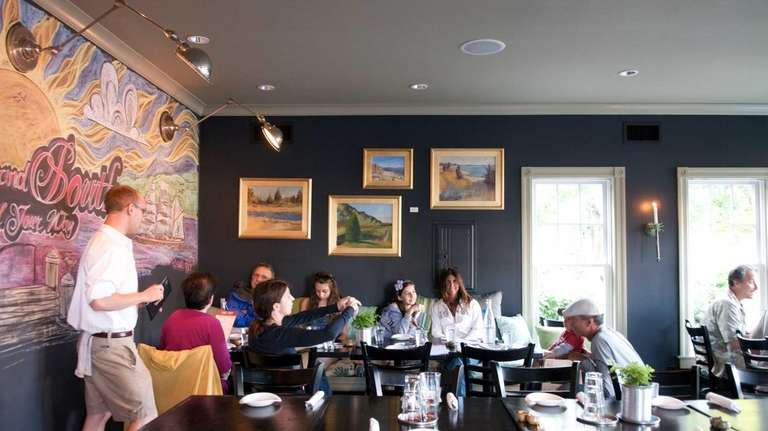 Chalkboard illustrations and local artist's paintings adorn the