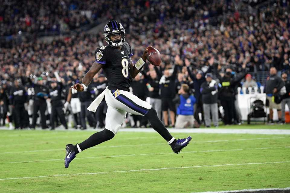 Baltimore Ravens quarterback Lamar Jackson scores on a