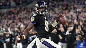 Baltimore Ravens quarterback Lamar Jackson scores on a