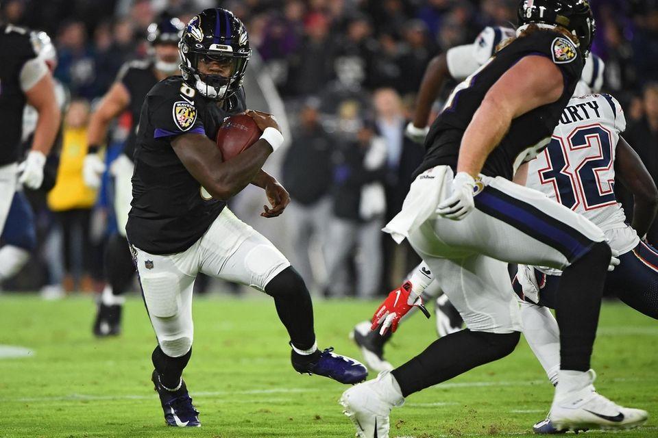 Quarterback Lamar Jackson of the Baltimore Ravens rushes