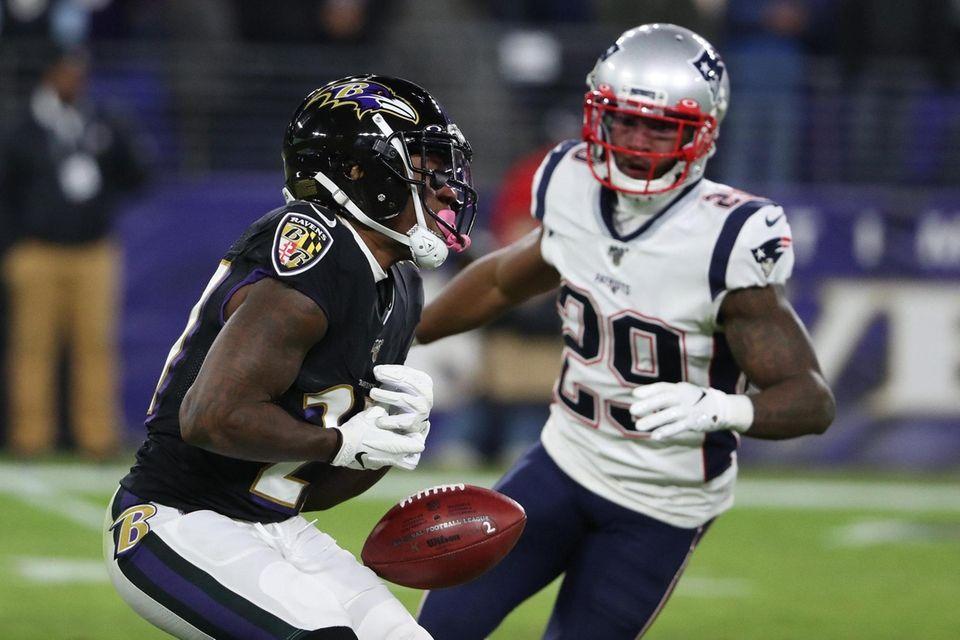 Cyrus Jones of the Baltimore Ravens fumbles in
