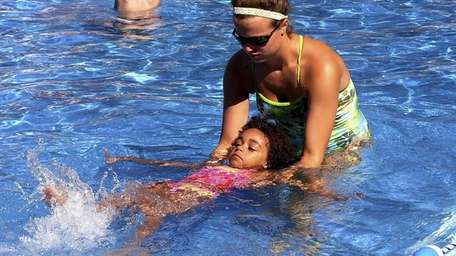 A camper learns how to swim at Harbor