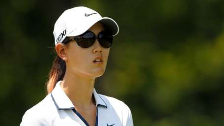 Michelle Wie walks down the 7th hole during
