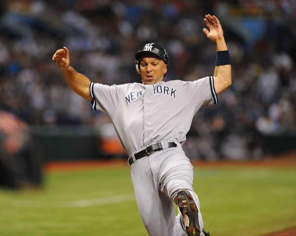 Raul Ibanez scores a run during the fourth