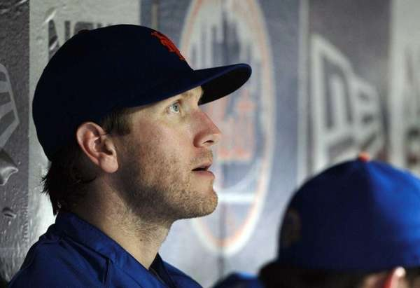 Jason Bay sits in the dugout during a