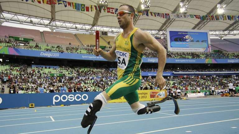 South Africa's Oscar Pistorius competes in a qualification