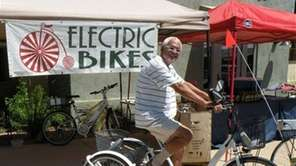Fermin Cruz demonstrates one of the electric bikes