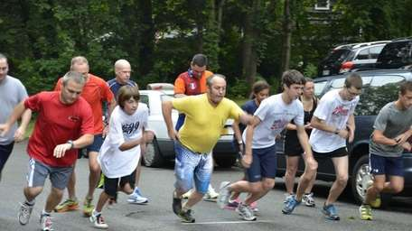 Runners take off in the adult 1-mile race