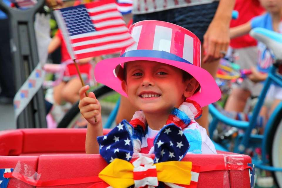 Jake Gonzalez, 3, shows his patriotism as he