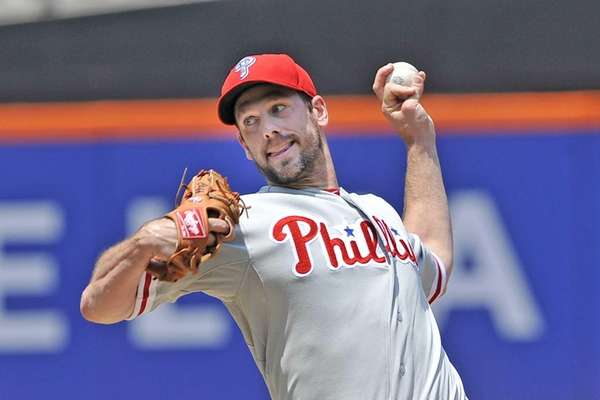 Cliff Lee delivers to the plate during a
