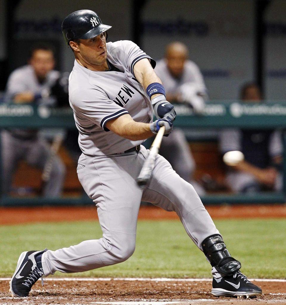 Mark Teixeira hits a home run during the