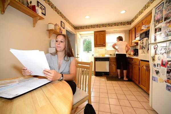 Kristina Cavallo looks over her resume as she