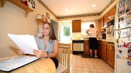 Kristina Cavallo looks over her resume as she