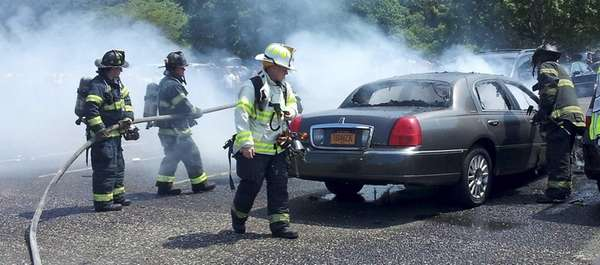 Firefighters extinguish a car fire that took place